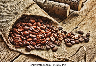 coffee beans in  bag on a old wooden background