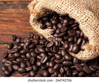 Coffee beans in bag on wooden table