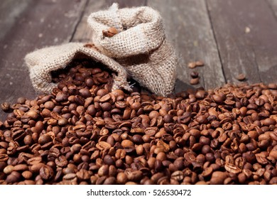 Coffee beans in bags filled with coffee beans background