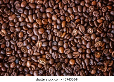Coffee beans  brown background