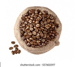 Coffee beans in burlap sack. Coffee top view.