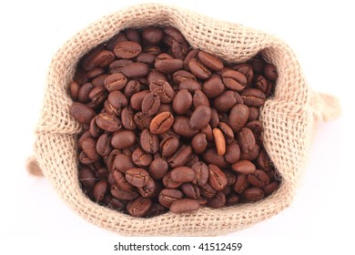 Coffee beans in canvas coffee bag isolated on white