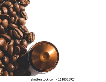 Coffee Beans and Capsule on White Background Texture Top View Copy Space