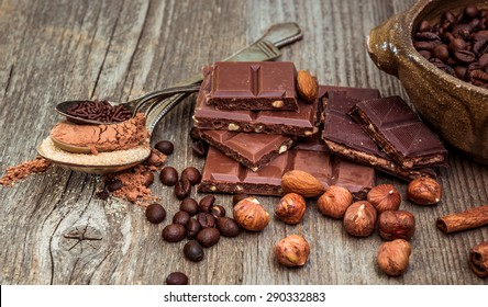 coffee beans and chocolate on a wooden background.