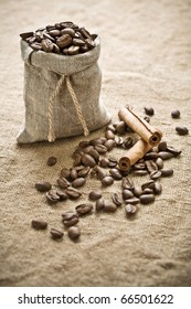 coffee beans and cinnamon on sacking