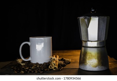 Coffee beans with classic white cup of organic black liquid cof