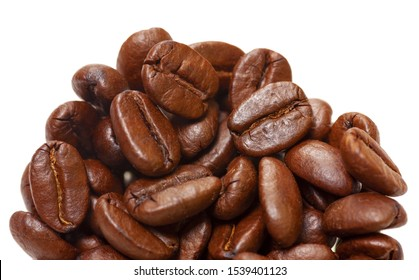 Coffee beans in close up view. Coffee background. Partly isolated on white. Soft focus view.