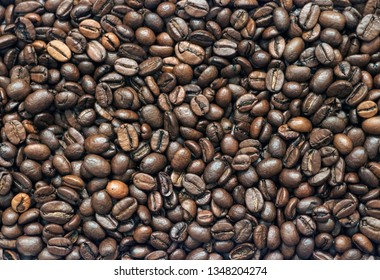 Coffee Beans. Close-up of coffee beans background. Coffee Beans. Roasted coffee beans. Great for use as background for your website or as a wallpaper.