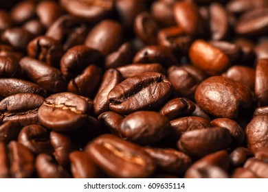 Coffee beans, close-up, black background, selective focus
