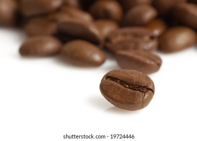 Coffee beans close-up where only the nearest beans are in focus