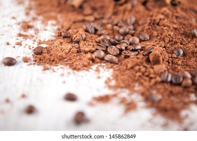 coffee beans and cocoa on a wooden board