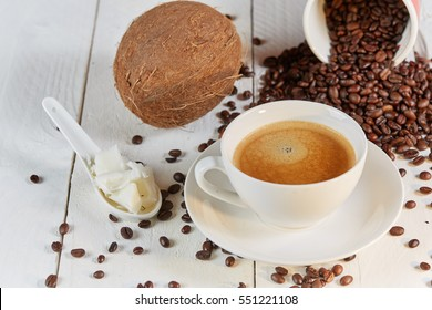 Coffee beans and coconut on white table for coffee