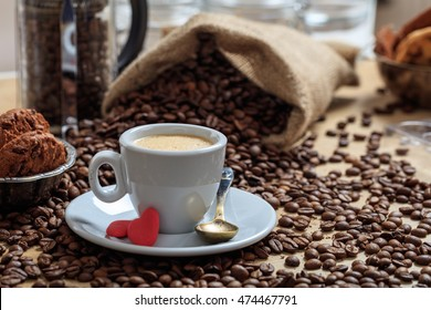 Coffee beans and a cup of coffee