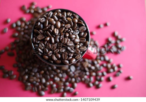 coffee-beans-cup-600w-1407109439.jpg