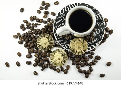 Coffee beans, cup and bitcoin coins laying on white background