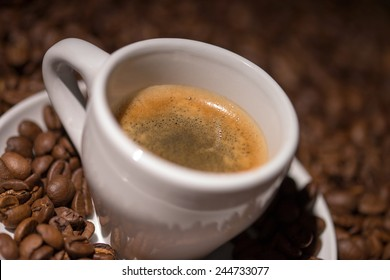 Coffee beans with a cup of espresso / Coffee