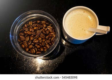 Coffee beans and cup of coffee with extra light