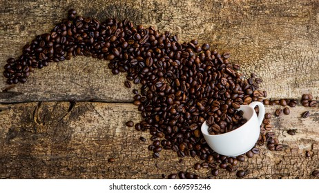 Coffee. Coffee beans. Coffee cup full of coffee beans.