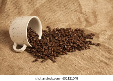 Coffee beans and cup. Image can be used as a background and texture