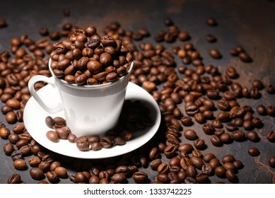 Coffee beans in coffee cup on black background. Place for your tex. Copy space