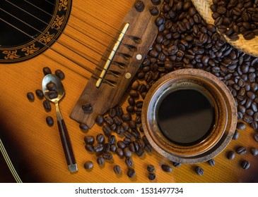 coffee beans with coffee cup on a guitar