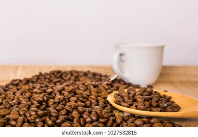 coffee beans and coffee cup on table.