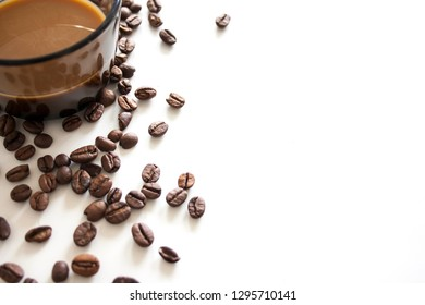 Coffee beans and coffee cup on white background. Frame of coffee with copy space for text.