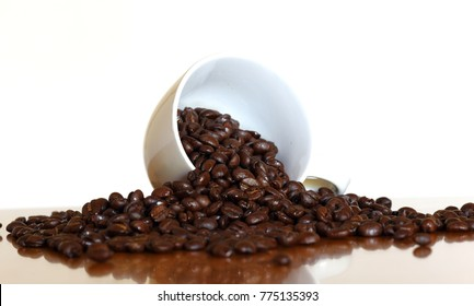 Coffee beans in coffee cups upside down selective focus and shallow depth of field