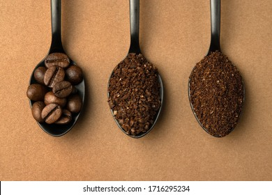 Coffee beans and different grinding coffee - coarse coffee, finely ground coffee in black spoons. Top view close-up.