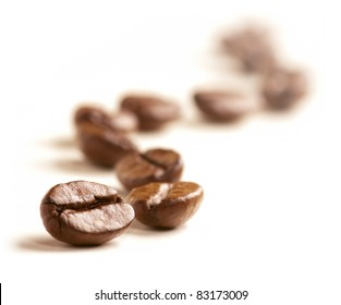 Coffee Beans draw a zigzag line isolated on white. Soft focus.