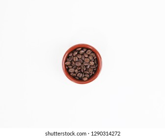 Coffee beans in earthen bowl