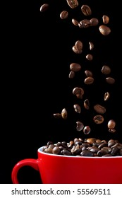 Coffee beans, falling into cup