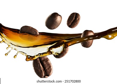 Coffee Beans Falling Into Glass of Hot Coffee Splash