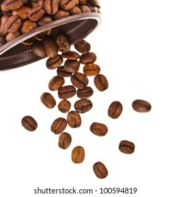 Coffee beans falling on white background