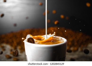 Coffee Beans falling while creamer mixes with coffee