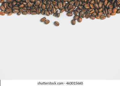 Coffee beans frame in white background. Coffea arabica