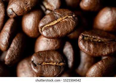 coffee beans fresh roasted morning beverage up close aroma smell taste good macro texture room for text holiday drink pick me up