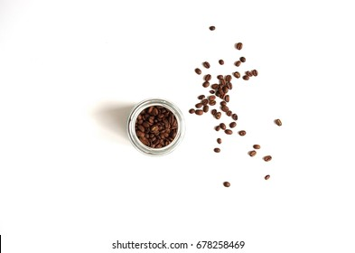Coffee beans in a glass jar top view
