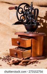 coffee beans, ground coffee, cinnamon, old wooden coffee grinder