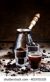 Coffee beans, ground coffee, espresso in a glass, coffee, vintage wooden background, selective focus