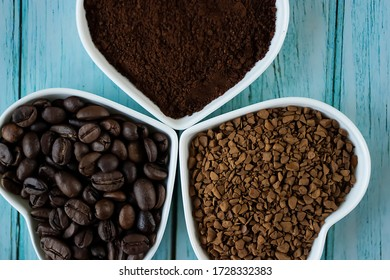 Coffee beans, ground coffee and freeze-dried coffee on blue wooden background. Soft focus.
