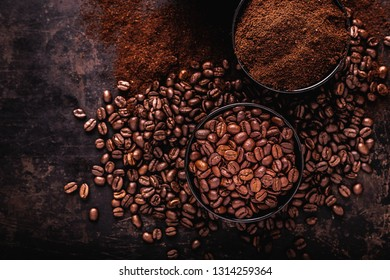 Coffee beans, ground coffee and instant coffee on a dark background, top view