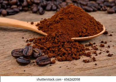 coffee beans and ground coffee on a wooden background