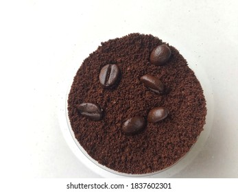Coffee beans and ground powder
