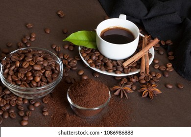 Coffee beans and ground powder on brown background.