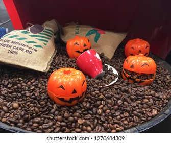 coffee beans with holloween pumpkin decoration
