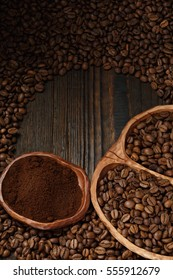 coffee beans and instant coffee in a wooden plates on a dark background