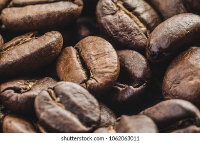 Coffee beans isolated on background close up