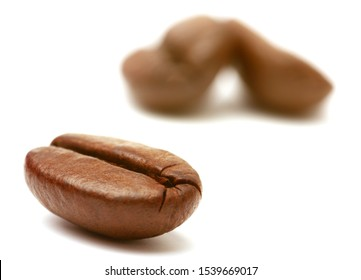Coffee beans Isolated on white background. Soft focus closeup view.