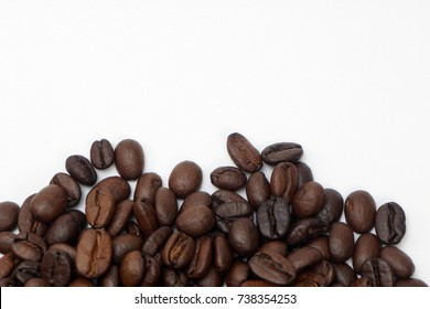 Coffee beans isolated on white background. Copy space.